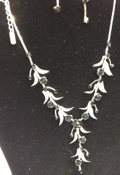 silver leaf and black rose necklace